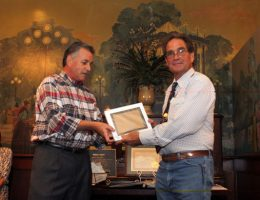 Gary Lasko, co-owner of the Stockyards giving Phil Tovrea (grandson to E.A. Tovrea) the honorary plaque as a reminder of their impact on local Arizona history.
